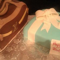 Tiffany Box Cake And Purse Cake Louis Vuitton Purse and Tiffany's Gift Box Cake. Purse is Red Velvet covered in chocolate fondant. Made stitching details and zipper...