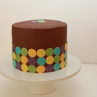 Chocolate On Chocolate Topped With Chocolate Dark chocolate ganache gluten free birthday decorated with a simple, modern random circle pattern.