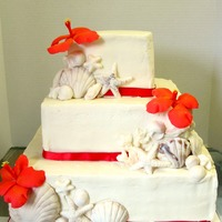 Seashell Cake 2nd official wedding cake! Square buttercream cake with chocolate seashells and fondant hibiscus. TFL!