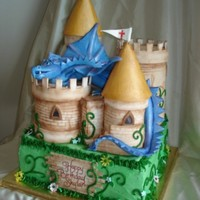 Skylar's Magical Birthday Cake  Skylar is my 10 year old who loves dragons. It is gumpaste covered styrofoam castle. The dragon is gum paste. The whole castle was on a...