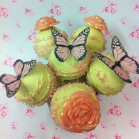 Girly Cake Pops Rice paper butterflies, white chocolate roses.