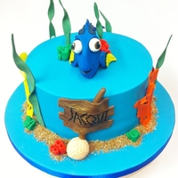 Dory Finding Nemo Cake  Finding Nemo cake featuring Dory as the star! All decorations are hand modeled out of modelling chocolate except the seaweed which is...
