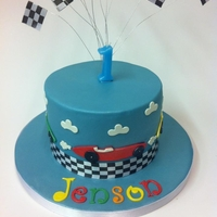 Race Car Cake   Based on the Planet Cake design. Matching cake pops.