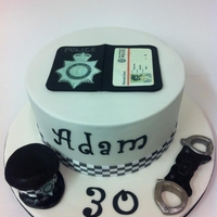 Cake For A Policeman Modelling chocolate handcuffs, hat and badge. The badge has 2 edible images on it. The warrant card I photoshopped on my computer.