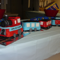 Choo Choo Train The cakes were baked in loaf pans so I didn't have to carve anything. I used tons of rice krispy treats. Each car is ontop of RTCs to...
