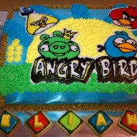 Angry Birds Cake   Angry Birds! Image is a FBCT. Letters (ELIAH), and #7 are candy melt sitting on nfsc decorated with royal icing.