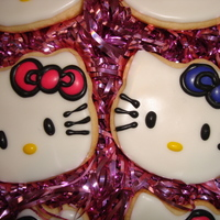 Hello Kitty Sugar Cookies NFSC decorated with royal icing. Hello Kitty sugar cookies for 2 birthday girls!