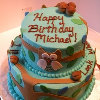 Look Whooooo's 1! Buttercream frosted cake with fondant decor. Owls, trees, leaves and acorns out of fondant