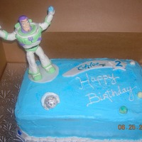 Buzz Lightyear This was my first attempt at modeling chocolate. The Buzz character and the asteroids on the cake were solid modeling chocolate. The...