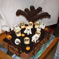 Graveyard Cake Chocalate buttecream, tree is semi sweet choc, fondant ghost and pumpkins, headstones are cookies