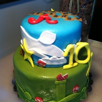 Super Mario Bros. This was a cake done for Andrew, a sibling of a sick baby. I was called to action for Icing Smiles, Inc. Marble cake with vanilla frosting...