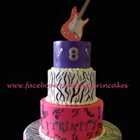 Rock Star Cake Buttercream cake with fondant details... zebra stripes was hand painted, musical notes was made with the cricut... gumpaste guitar. TFL