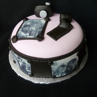 "Camera Memories 9"" chocolate cake. Covered with edible images of the family. Camera is RKT covered in fondant"