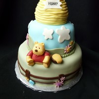 "Winnie The Pooh 10"" and 6"" tiers of white velvet cake, torted with buttercream. The humidity made things difficult with the buttercream -- it..."