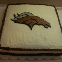 "Lsn Broncos Wrestling Banquet Cake Cake covered in buttercream with fondant ""bronco head"" decoration."