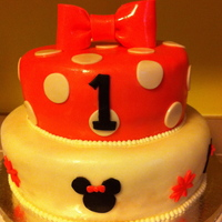 "Minnie Mouse 1St Birthday Cake 12 and 8 inch cake covered in fondant with fondant accents. Bow made of fondant. ""Smash cake"" made using mini-wondermold pan and..."
