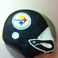 Pittsburg Steelers Cake Cake made using Wilton helmet pan and then covered in fondant with fondant accents