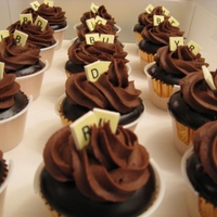 Scrabble Cupcakes  Cupcakes are chocolate mousse filled, dipped in dark chocolate ganache and topped with chocolate buttercream. Scrabble letters are edible...