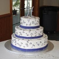 Purple Scroll Wedding Cake Wedding cake with purple scrolls. Ribbon is fondant. The scrolls have tiny paw prints incorporated into the design, per the bride and groom...