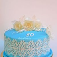 Blue Sugarveil Cake Blue cake , white sugarveil and pulled sugar roses
