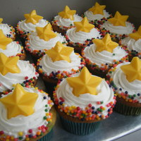 Star Cupcakes I made these to go with a brightly colored number one cake for a little boy's first birthday. They were funfetti cupcakes with...