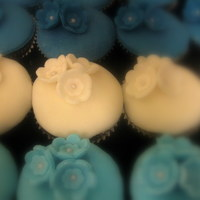 Blue And White Cupcakes   fondant topped cupcakes with flower accents.