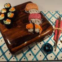 Sushi Cake Design based on Confetti... The california rolls and sushi are made from RKT and fondant. Using a pasta maker helped with all the shredding...
