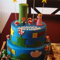 "Super Mario Bros  Iced in BC, fondant accents, plastic characters. Tunnel is TP roll wrapped in fondant, sculpted mushrooms. Tiers are 10""/8""...TFL..."