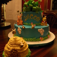 First Birthday And Smash Cake Winnie the Pooh, Tigger, Eeyore, Piglet and 9 bumblebees are all made of fondant. They are part of a buttercream icing, yellow 2 tier cake...