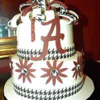 Rolltide Birthday Two tiered buttercream cake with fondant accents.