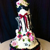 Topsy Turvy Zebra Print Corset Wedding Cake Topsy Turvy construction, corset cake, gum paste flowers, mixed shape cakes, in hot pink and black.