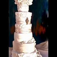 Elegant White Wedding Cake Mixed shape cake with custom frame. Gum paste flowers and over piped appliques.