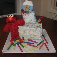 Austin's Elmo Cake  This was for my son's 2 year old birthday party. After I took this picture, the topsy turvy look collapsed and I had to restack and...