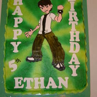 Ben 10 hand drawn on thin rolled fondant, cut and hand painted. Airbrushed background.