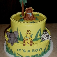 Fondant Zoo Animals   I loved doing this cake. It was buttercream with all fondant animals and accents