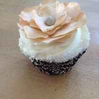 Elegant Wedding Cupcake I actually made this cupcake for a wedding cake tasting just to demonstrate an option on a flower being used for the actual cake itself. I...