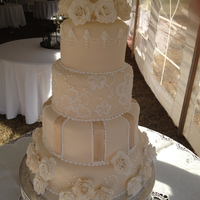 Ivory Rose Wedding Cake This is a round wedding cake I did for a sorority sister. All the roses are handcrafted with some dusted in old gold lustre dust and some...