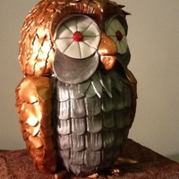 Bubo From Clash Of The Titans made for cake central comp because im a bit of a geek ! just basic choc fudge cake as a base but bubos made from rct and gumpaste