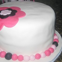 Chunky With A Hat Fondant cake with fondant accents.