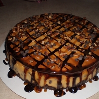 Turtle Cheesecake Turtle cheesecake with chocolate, caramel and pecans