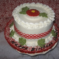 Red Mum Geometric. Carrot cake with cream cheese frosting. Fondant, wilton frosting sheets & candy melt accents.