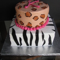Square Zebra And Round Cheetah This is a cake I made for my children's babysitter for her 17th birthday. She loves animal print and found a picture of a cake she...