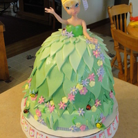 Tinkerbelle Doll Birthday Cake My 2yr old niece loves Tink so...this was perfect for her. Tinkerbelle doll in a cake, strawberry, confetti cake with vanilla mousse...