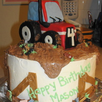 "Mud And Tractors 10"" double layer cake with mousse filling and buttercream icing. Modeling chocolate accents on the cake and some candy chocolate &quot..."
