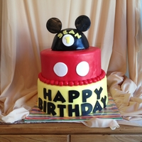 Mickey Mouse Cake Mickey Mouse cake all yellow cake fondant covered. All decorations fondant.