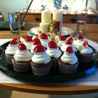 Christmas Cupcakes Red Velvet cupcakes with santa hats.