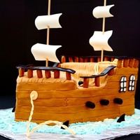 Pirate Ship Cake Chocolate cake with buttercream frosting and covered with MMF. I cut all the floor boards and side planks by hand and laid them...