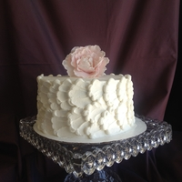 Piped Peony Cake White cake with vanilla buttercream. Design around the sides is pipped buttercream.TFL