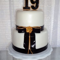 Black And Gold A photo was given to me to make this cake, so I am not sure who designed it. Both tiers are red velvet, iced in buttercream, and covered in...