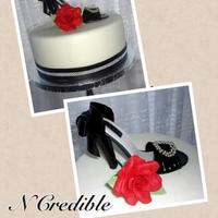 "Kaitlyn's Cake 10"" round, covered in fondant with a gumpaste shoe and rose. Thank you for looking!"